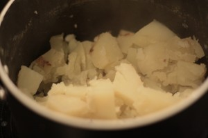 Put potatoes back into saucepot.  Turn heat to low and stir the potatoes to dry them out for about a minute.  Turn off heat.