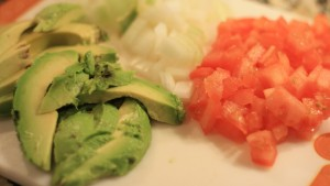 Chop 1 Roma tomato, ½ onion, and cut avocado in slices.  Shred 1 cup of lettuce.