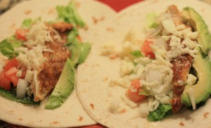 Layer ½ fish filet and some of the vegetables onto each tortilla.  Sprinkle with fresh shredded mozzarella.