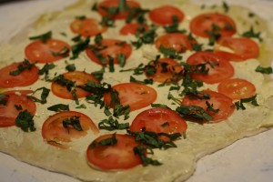Layer the tomatoes and basil on top of dough.