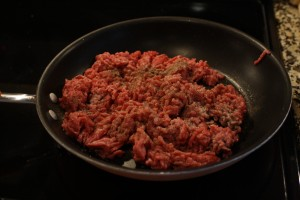 Brown ground beef in skillet.  Add ¼ tsp salt, 1/2 tsp ground black pepper,  ½ tsp oregano, and 1/8 tsp allspice.  Stir to combine.  Drain the grease from the pan.