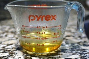Make the honey simple syrup by combining ¼ cup honey and ¼ cup hot water in a heat resistant measuring cup (again, water doesn't have to be too hot.  The hot water from the faucet is fine.).  Stir until honey is dissolved.