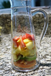 Place the fruit into a pitcher.