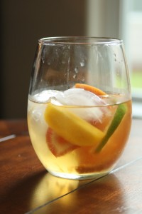 Place a few ice cubes into a glass (it looks really cute is small mason jars), and pour sangria over ice. Serve.