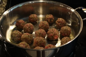Add the meatballs to the skillet to brown.