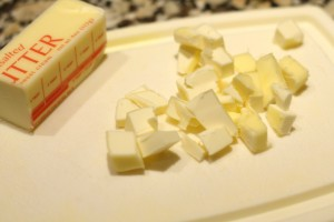 Cut the 3 tbsp of unsalted butter into small cubes.  Add the cubes to the topping mixture.