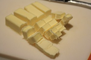 Cut the 1/3 cup butter into small cubes.