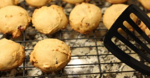 Carefully scoop cookies off of baking sheet with a spatula, and place cookies onto a cooling rack.  If you don't have a cooling rack, just lay some paper towels out and set the cookies on the paper towels.  The cookies will be extremely hot, so use caution.