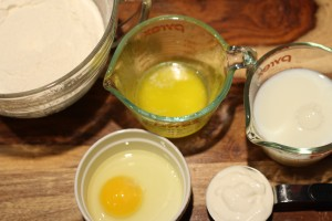 Next add the melted butter, egg, sour cream, and milk.