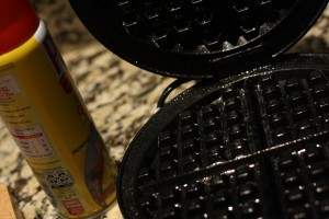 I spray my waffle iron with non-stick cooking spray…like I've done here.  This helps to keep the waffles from sticking…follow your manufacturer's instructions…