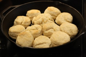 Use your oven mitts when taking the pan out of the oven; the pan and biscuits will be extremely hot. Allow the biscuits to cool a few moments before serving.
