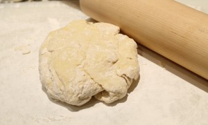 Dust the work surface with a little flour.  Be sure to dust your hands, rolling pin, and top of dough.