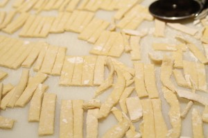 I take the scraps and trim them up a little neater and cut them into noodles as well.
