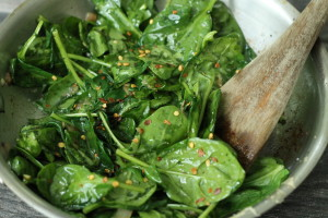 Add seasonings to spinach